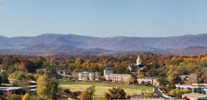Panorama of the University of North Georgia, with trees and mountain ranges in the background