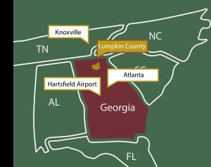 A map showing lumpkin county in relation to Atlanta, Hartsfield Jackson International Airport, Port of Savannah, Alabama, South Carolina, North Carolina and Tennessee.