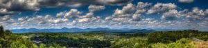 Dahlonega panorama of the mountains, tree tops, sky and clouds