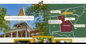 A screenshot of the Lumpkin County Development authority website. Features a map of Lumpkin county in relation to Georgia as a state, and shows distance from Atlanta, Hartsfield Jackson International airport, and the surrounding states, including Alabama, Florida, South Carolina.